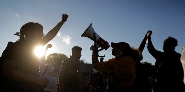 Protesters blocking a street outside the police station in Florissant, Mo., last week.