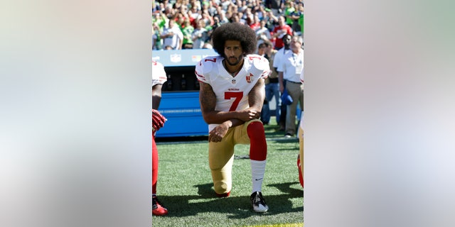 San Francisco 49ers' Colin Kaepernick kneels during the national anthem before an NFL football game against the Seattle Seahawks in Seattle Sept. 25, 2016. He has not found an NFL job in the last three seasons. (AP Photo/Ted S. Warren, File)