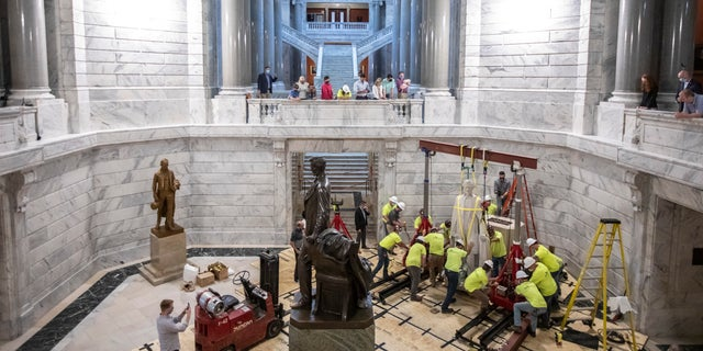 """""""Now, every child who walks into their Capitol feels welcome. Today we took a step forward for the betterment of every single Kentuckian,"""" said Gov. Andy Beshear. (Ryan C. Hermens/Lexington Herald-Leader via AP)"""