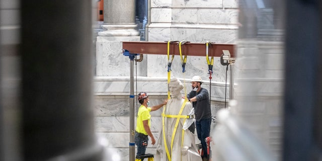 Calls to remove Confederate monuments, seen as symbols of slavery, have swept the nation following the death of George Floyd in police custody in Minneapolis on May 25.(Ryan C. Hermens/Lexington Herald-Leader via AP)