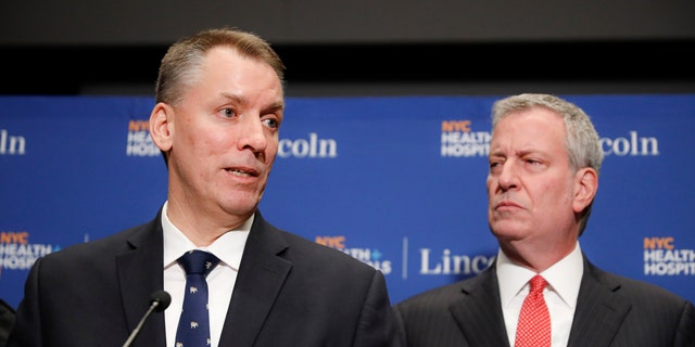 New York City Police Commissioner Dermot Shea, left, speaks alongside Mayor Bill de Blasio during a news conference in New York in February. The NYPD announced in June it is disbanding its Anti-Crime Unit. (AP)