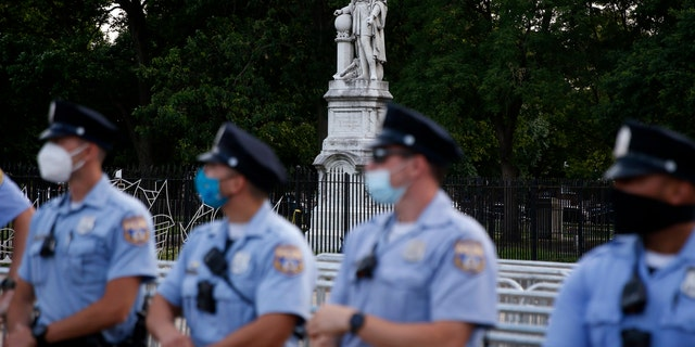 Philadelphia police officers gather near the statue of Christopher Columbus at Marconi Plaza, Monday, June 15, 2020, in the South Philadelphia neighborhood of Philadelphia. (Associated Press)