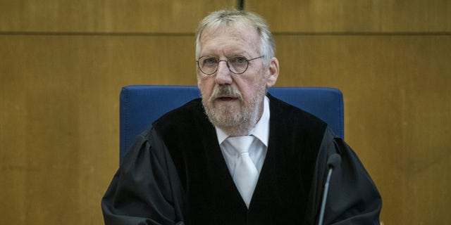 Presiding judge Thomas Sagebiel arrives on the first day of the trial in the case of murdering Walter Luebcke at the Oberlandgericht Frankfurt courthouse, in Frankfurt, Germany, Tuesday, June 16, 2020. (Thomas Lohnes/Pool via AP)