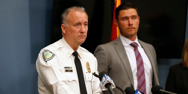 Florissant Police Chief Timothy Fagan, left, speaking alongside St. Charles County Prosecuting Attorney Tim Lohmar, right, during a news conference Wednesday.