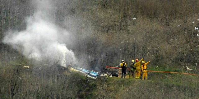 <br> Firefighters work the scene of a helicopter crash where former NBA star Kobe Bryant died in Calabasas, Calif., Jan. 26, 2020. (Associated Press)