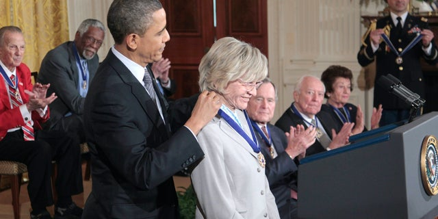 FILE - In this Feb. 15, 2011 file photo, President Barack Obama presents a Medal of Freedom to Jean Kennedy Smith during a ceremony in the East Room of the White House in Washington. Jean Kennedy Smith, the youngest sister and last surviving sibling of President John F. Kennedy, died at 92, her daughter confirmed to The New York Times, Wednesday, June 17, 2020. (AP Photo/Pablo Martinez Monsivais)
