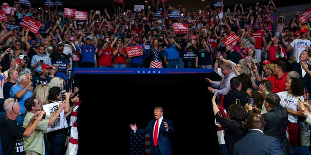 President Trump arriving on stage to speak at the campaign rally in Tulsa on June 20