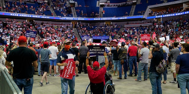 Supporters of President Trump listen to him speak during a campaign rally at the BOK Center in Tulsa, Okla., June 20, 2020. (Associated Press)