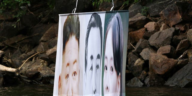 A banner with images of North Korean leader Kim Jong Un, left, the late leader Kim Il Sung, center, and Kim Yo Jong, the powerful sister of Kim Jong Un, released by Fighters For Free North Korea, is seen in Hongcheon, South Korea, Tuesday, June 23, 2020. (Yang Ji-woong/Yonhap via AP)