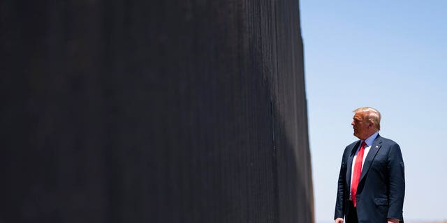 President Donald Trump tours a section of the border wall, Tuesday, June 23, 2020, in San Luis, Ariz. (AP Photo/Evan Vucci)