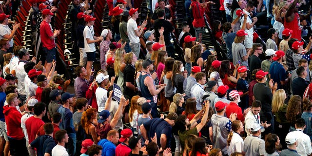 Supporters listen as President Trump speaks to a group of young Republicans at Dream City Church, Tuesday, June 23, 2020, in Phoenix. (AP Photo/Evan Vucci)