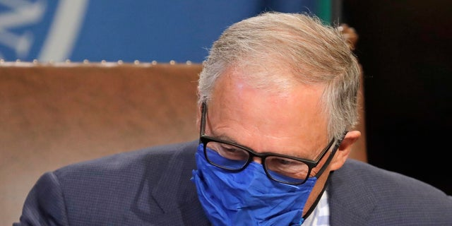 Washington Gov. Jay Inslee wears a face mask as he concludes a news conference at the Capitol in Olympia, June 23, 2020, . (Associated Press)
