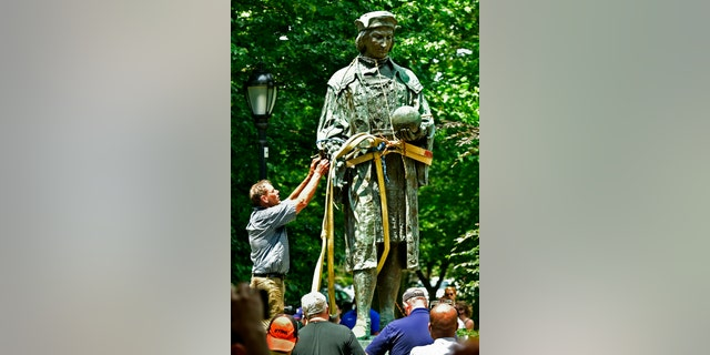 A statue of Christopher Columbus is removed from Wooster Square Park in New Haven, Conn., Wednesday, June 24, 2020. (Associated Press)