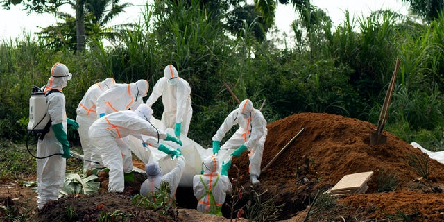 FILE - In this Sunday, July 14, 2019 file photo, an Ebola victim is put to rest at the Muslim cemetery in Beni, Congo. Eastern Congo on Thursday, June 25, 2020 has marked an official end to the second-deadliest Ebola outbreak in history that killed 2,280 people over nearly two years as armed groups and community mistrust undermined the promise of new vaccines. (AP Photo/Jerome Delay, File)