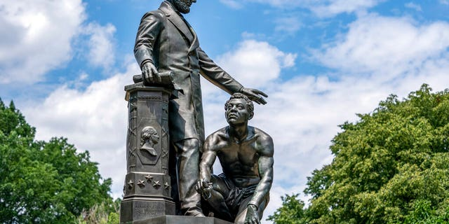 The Emancipation Memorial in Washington's Lincoln Park depicts a freed slave kneeling at the feet of President Abraham Lincoln, Thursday, June 25, 2020. Calls are intensifying for the removal of the statue as the nation confronts racial injustice. (AP Photo/J. Scott Applewhite)