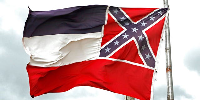 A Mississippi state flag flying outside the Capitol in Jackson, Miss.