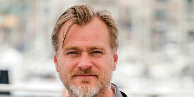 FILE - In this May 12, 2018, file photo, director Christopher Nolan poses during a photocall at the 71st international film festival in Cannes, southern France.