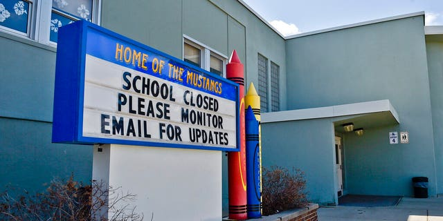 A sign announcing an elementary school in Helena, Mont., was closed.