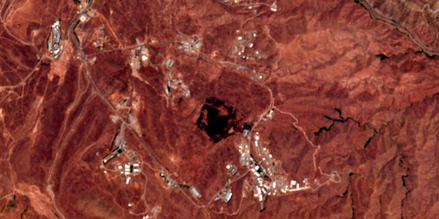 This Friday, June 26, 2020, photo from the European Commission's Sentinel-2 satellite shows the site of an explosion that rattled Iran's capital. Analysts say the blast came from an area in Tehran's eastern mountains they hides a underground tunnel system and missile production sites. The explosion appears to have charred hundreds of meters of scrubland. (European Commission via AP)