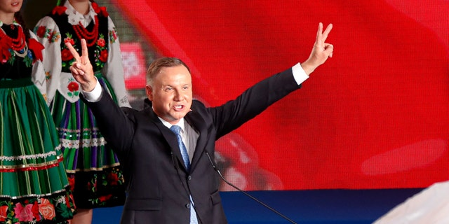 President Andrzej Duda flashing victory signs after voting ended in Lowicz, Poland, on Sunday.