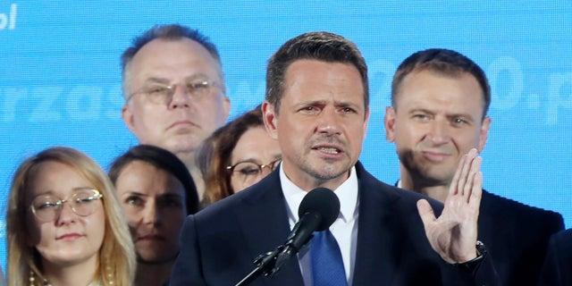 Warsaw Mayor Rafal Trzaskowski, front, reacting to the exit poll Sunday.