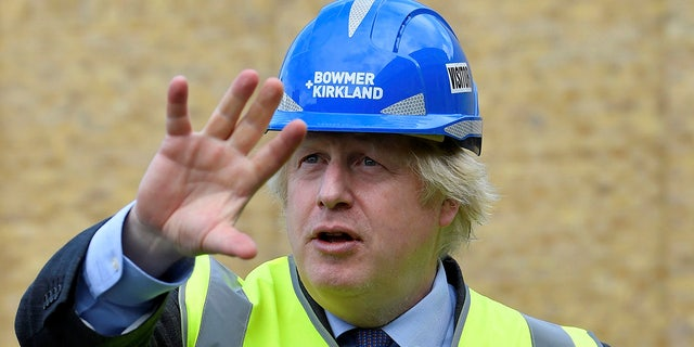Britain's Prime Minister Boris Johnson visits the construction site of Ealing Fields High School in west London on Monday, June 29, 2020. (Toby Melville/Pool via AP)