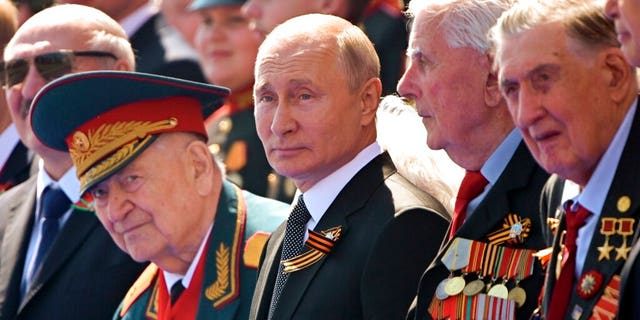 FILE: Russian President Vladimir Putin, center, watches the Victory Day military parade marking the 75th anniversary of the Nazi defeat in Moscow.
