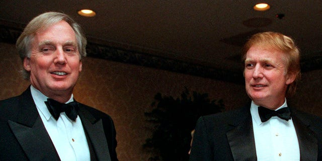 Robert Trump, left, joins brother Donald Trump at an event in New York City, Nov. 3,1999. (Associated Press)