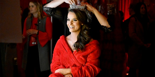 Miss America Camille Schrier prepares backstage at The American Heart Association's Go Red for Women Red Dress Collection 2020 at Hammerstein Ballroom on February 05, 2020, in New York City.