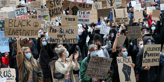 Protesters take part in a demonstration in Southampton, England, Wednesday, June 3, 2020, over the death of George Floyd, a black man who died after being restrained by Minneapolis police officers on May 25. (Andrew Matthews/PA via AP)