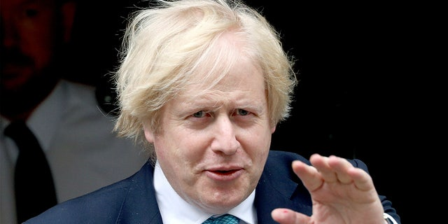 Britain's Prime Minister Boris Johnson leaves 10 Downing Street in London Tuesday