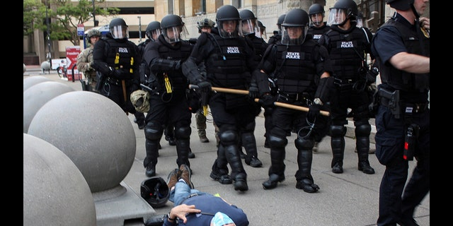 Martin Gugino, a 75-year-old protester, lays on the ground after he was shoved by two Buffalo, New York, police officers during a protest against the death in Minneapolis police custody of George Floyd in Niagara Square in Buffalo, New York, U.S., June 4, 2020. Picture taken June 4, 2020.
