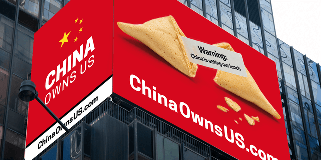 Times Square billboard endeavors to warn of creeping Chinese influence.