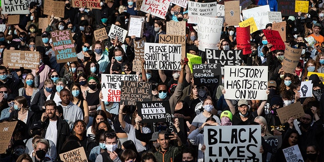 Thousands of people gather for a peaceful demonstration in support of George Floyd and Regis Korchinski-Paquet and protest against racism, injustice and police brutality, in Vancouver, on Sunday, May 31, 2020. (Darryl Dyck/The Canadian Press via AP)
