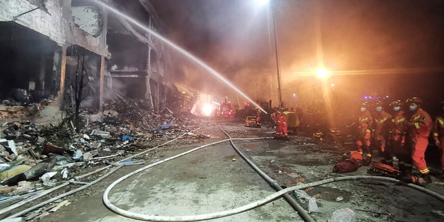 In this photo released by Xinhua News Agency, firefighters work at the site of buildings damaged after a tanker truck explosion on a highway in Wenling, in eastern China's Zhejiang Province on Saturday, June 13, 2020.