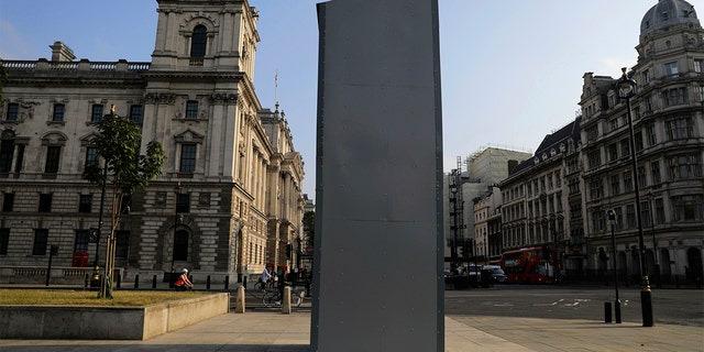 A protective covering installed overnight surrounds the statue of former British Prime Minister Sir Winston Churchill in Parliament Square, London, Friday, June 12, 2020, following Black Lives Matter protests that took place across the UK over the weekend. The protests were ignited by the death of George Floyd, who died after he was restrained by Minneapolis police on May 25. (Aaron Chown/PA via AP)
