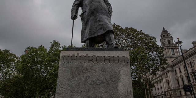 """LONDON, ENGLAND - JUNE 08: The Churchill statue in Parliament Square that had been spray painted with the words """"was a racist"""" on June 08, 2020 in London, England."""