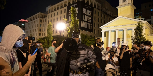 Protesters gather on Black Lives Matter Plaza after they attempted to pull down the statue of Andrew Jackson in Lafayette Square near the White House on June 22, 2020 in Washington, DC. Protests continue around the country over the deaths of African Americans while in police custody.