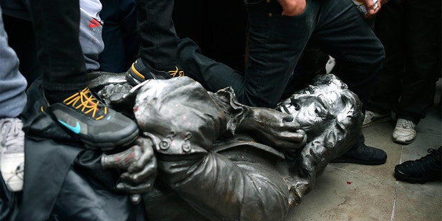 UK crowd tears down statue of 17th-century slave trader Edward ...