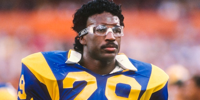 Eric Dickerson #29 of the Los Angeles Rams waits on the sidelines a National Football League game against the Houston Oilers played on December 17, 1984 at Anaheim Stadium in Anaheim, California. Dickerson set a new NFL single season rushing record during the game. (Photo by David Madison/Getty Images)