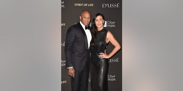 Dr. Dre and Nicole Young attend the 2018 City Of Hope Gala at Barker Hangar on October 11, 2018, in Santa Monica, Calif. (Photo by David Crotty/Patrick McMullan via Getty Images)