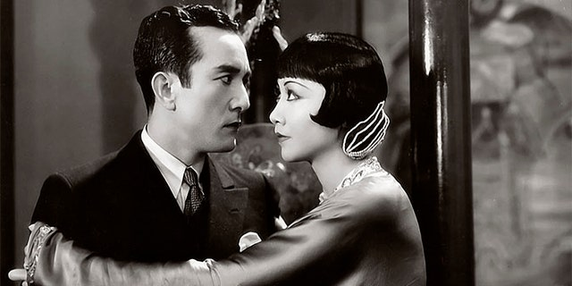 Actress Anna May Wong and Sessue Hayakawa with Harold Minjir in a scene from the movie 'Daughter of the Dragon.'