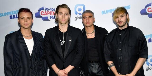 (L-R) Ashton Irwin, Luke Hemmings, Calum Hood, and Michael Clifford of 5SOS attend the Capital FM Summertime Ball at Wembley Stadium on June 08, 2019 in London, England.