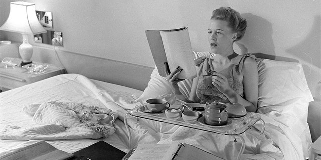 Joan Harrison reading a book, United States, 1945.