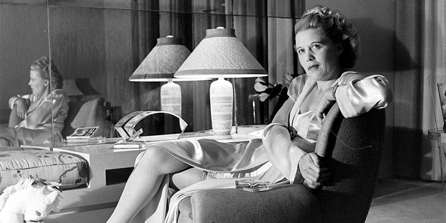 Joan Harrison sitting on an accent chair, United States, 1945.