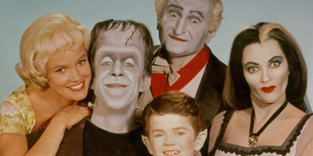 Pat Priest, Al Lewis and Butch Patrick along with Fred Gwynne and Yvonne De Carlo of the Munster family in a publicity photograph from the television series 'The Munsters,' circa 1964.