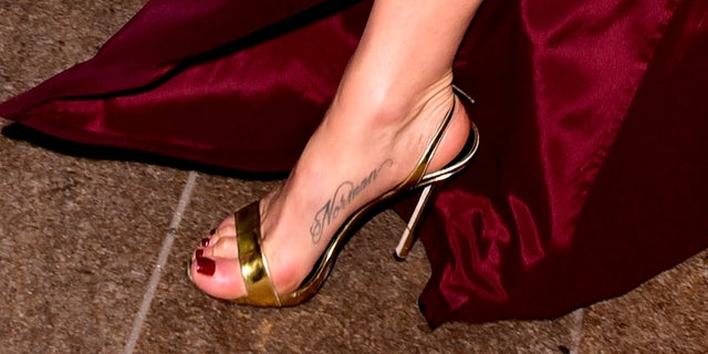 Jenifer Aniston reportedly received her first-ever tattoo in 2011 with the name of her dog Norman written on the inside of her right foot in a script font.(Photo by James Devaney/GC Images)