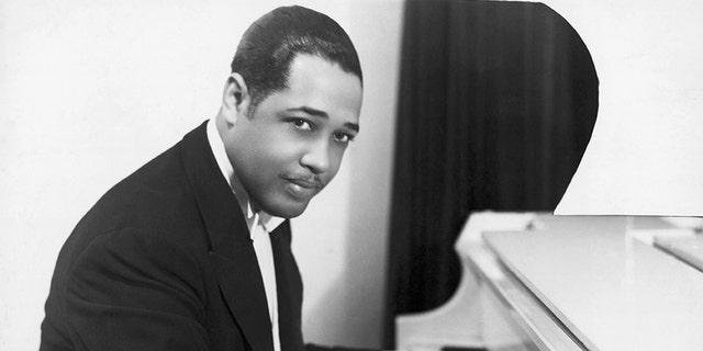 Duke Ellington, American composer and arranger, at the keyboard. Half-length photograph, 1910's.