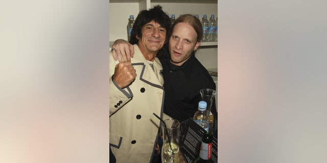 Ronnie Wood and Jamie Wood attend the launch party of Ronnie Woods Scream Gallery in Mayfair on May 20, 2006, in London, England.