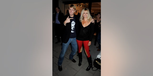 Jamie and Jo Wood attend the private view of 'Needleworks' by Sophie Delaporte, at the Scream Gallery on September 11, 2008, in London, England.